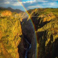 Aerial shot of rainbow over the Royal Gorge with Royal Gorge Bridge in the background. August 19, 2014